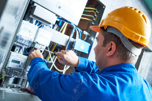 Electrician installing energy saving meter Canvas Print