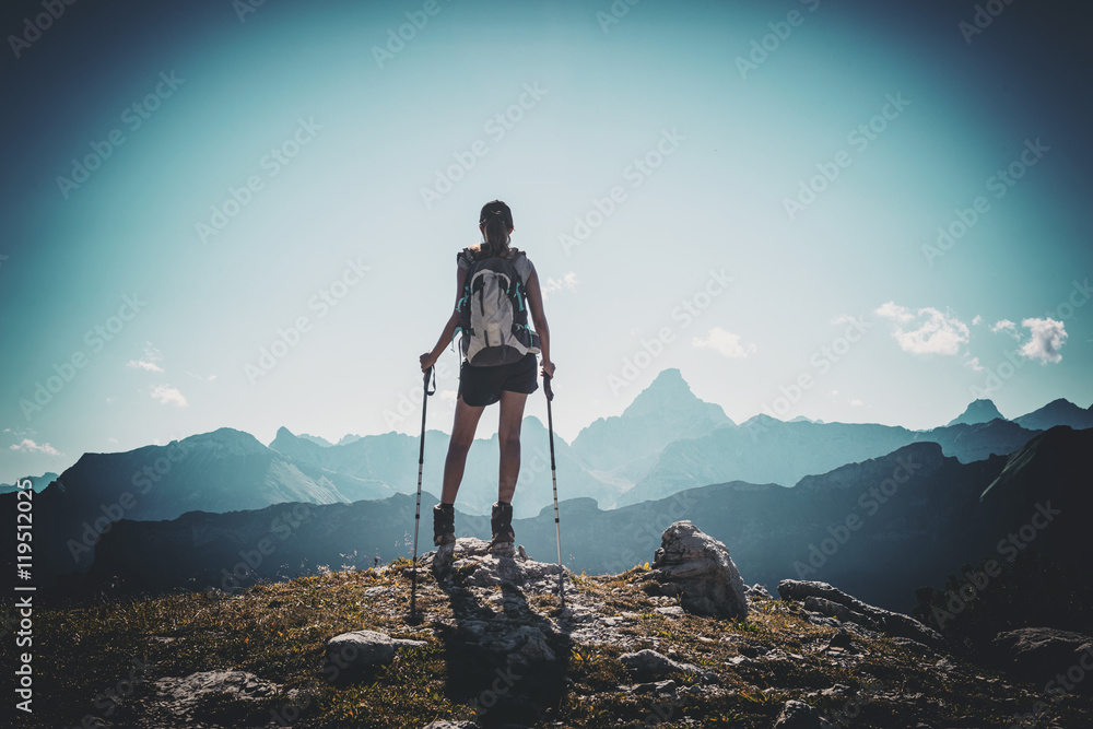 Fototapety, obrazy: Vignette of hiker with poles near summit