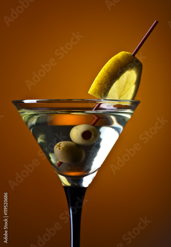 martini with lemon and green olives - 119520686
