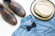 Men's casual outfits with jean shirt, brown leather shoes and brown hat, flat lay, top view background