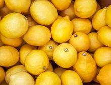 Background Of Yellow Lemons.