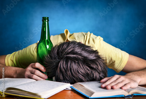 Valokuva  Student sleep with a Beer
