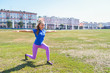 young happy woman doing stretching workout outdoors, yoga pose