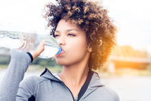 Girl Drinking Water From Bottle.