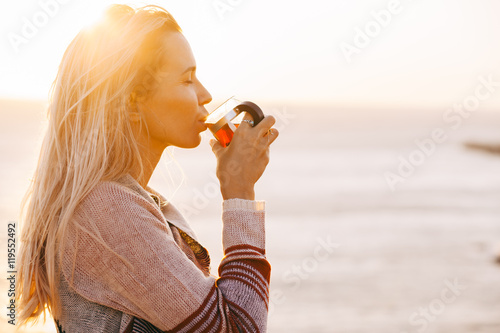 Fotografie, Obraz  Woman drinking tea outdoors