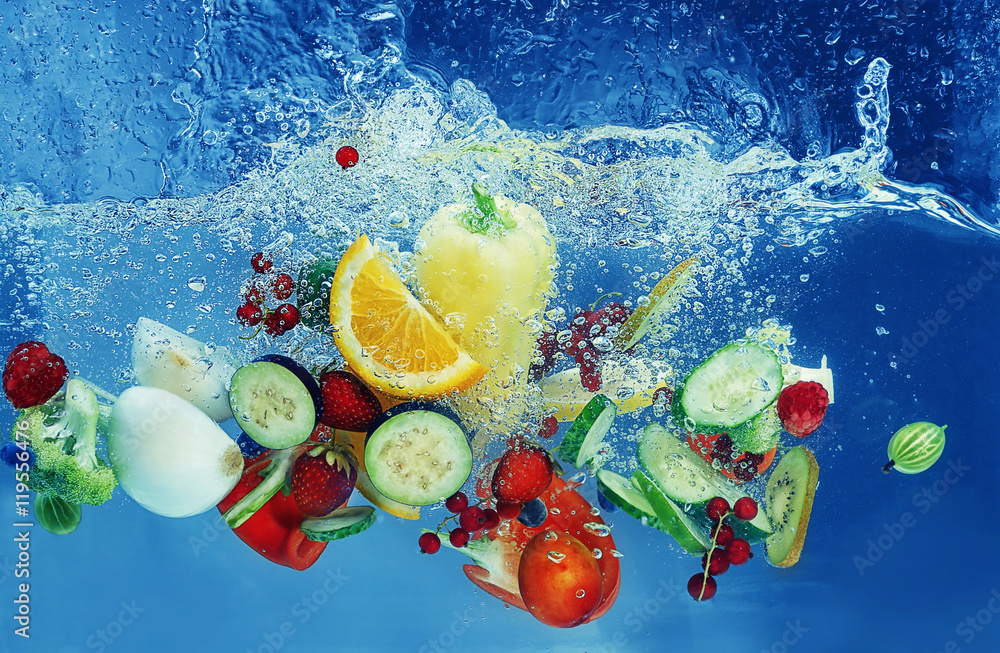 Fototapeta Vegetables and fruits falling into water on  color background