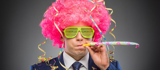 Funny businessman in pink wig