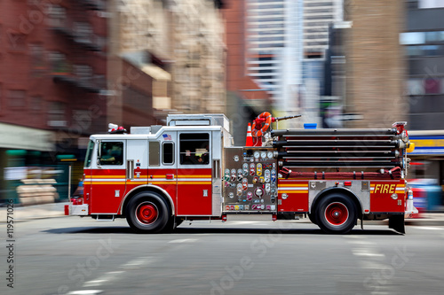 fire trucks and firefighters brigade in the city Tableau sur Toile