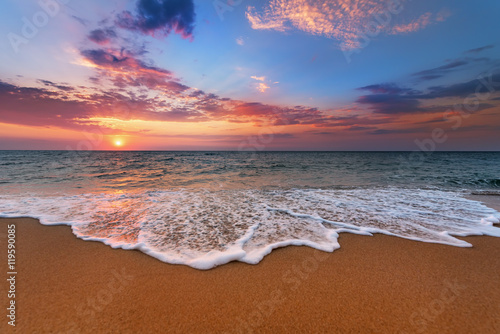 Foto auf Gartenposter Strand Colorful ocean beach sunrise.