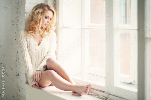 Fotografia, Obraz  Beautiful Woman with Blonde Looking out the Window