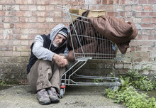 Homeless Man Out On The Streets With His Belongings In A Trolley.