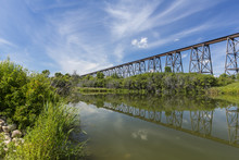 Railroad High Bridge / A Long And Tall Railroad Bridge Reflecting In A River.