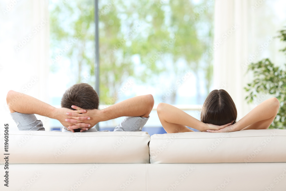 Fototapety, obrazy: Couple relaxing on a couch at home