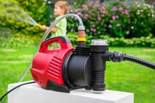 Modern Water Pump In Garden On...