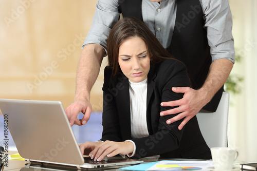 Fototapeta Harassment with a boss touching to his secretary obraz