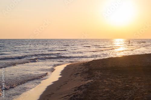 Spoed Foto op Canvas Zee zonsondergang Beautiful blue waves of adriatic sea during sunset
