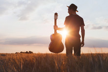 Silhouette Of Musician With Gu...