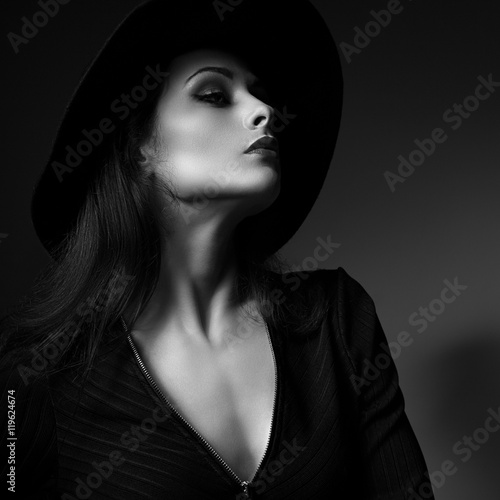 Fotografie, Obraz  Glamour sexy makeup woman profile posing in fashion hat on dark