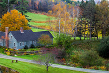 Farm House In Green Fields And Colorful Autumn Leaves