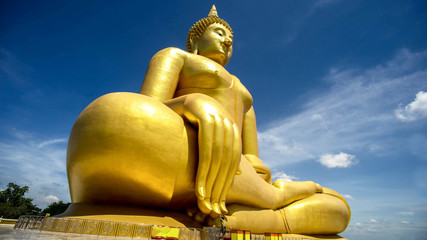 Fototapeta Religia i Kultura The women pray sacred to The Big Golden Buddha at Wat Muang, Ang