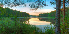 Panoramic Beautiful Landscape Of The Lake Surrounded By Forest In The Night.