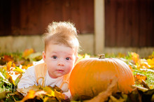 Baby Girl With Pumpkin