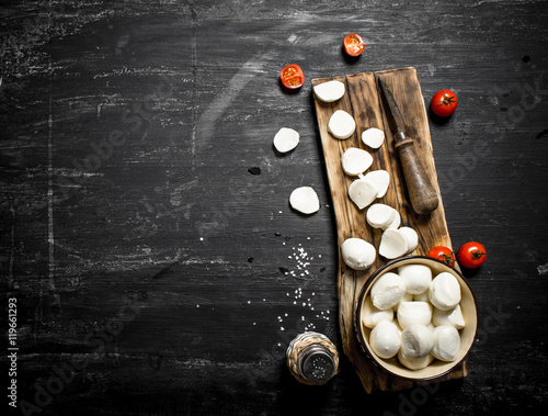 Fototapeta Mozzarella cheese with an old knife and tomatoes. obraz