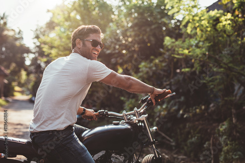 Fotografie, Obraz  Handsome young man on motorcycle