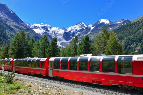 Foto  Swiss mountain train Bernina Express crossed Alps