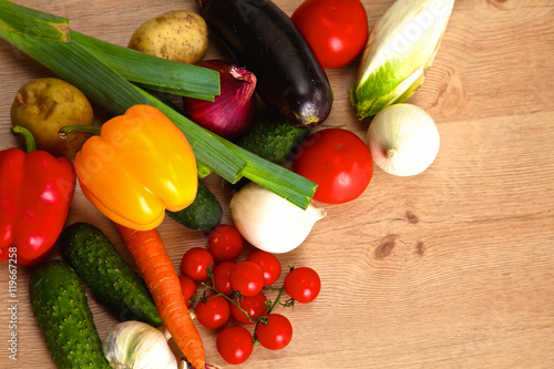 Fotobehang Pile of organic vegetables on a rustic wooden table
