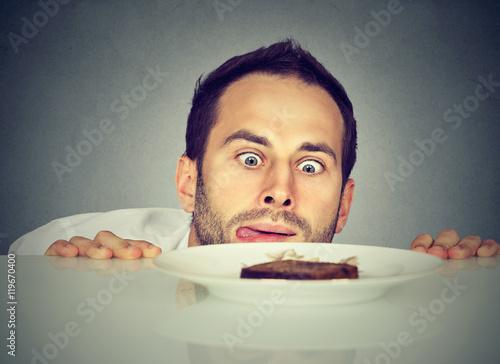 Fototapeta Hungry man craving sweet food