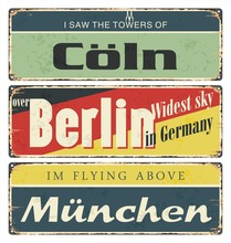 Vintage Tin Sign Collection With Germany Cities. Berlin. Munich. Cologne. Retro Souvenirs Or Postcard Templates On Rust Background.