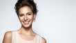 Leinwandbild Motiv Beautiful smiling woman with clean skin, natural make-up, and white teeth on grey background