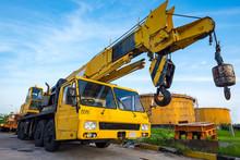 Yellow Mobile Crane Against Fu...