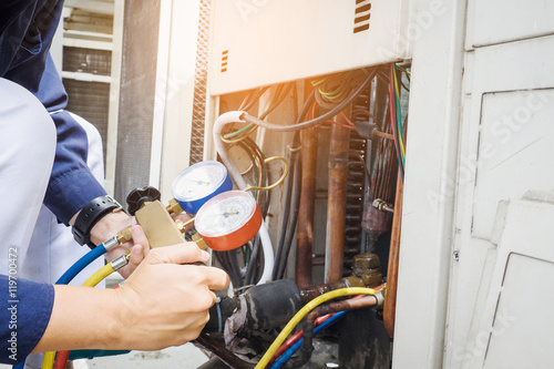 Technician is checking air conditioner Canvas Print