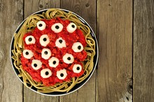 Halloween Cheesy Eyeball Pasta With Tomato Meat Sauce, Above View Over Old Wooden Background