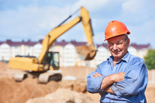Construction Worker Driver In Front Of Excavator Loader