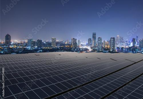 Obraz na plátně  Solar panel,Solar farm with twilight cityscape