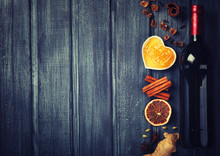 Mulled Wine,ingredients.Christmas Or Winter Warming Drink. Honey, Orange, Cinnamon Sticks, Cloves ,ginger,cardamom And Sugar.Toned Image.Vintage Style. Copy Space.selective Focus