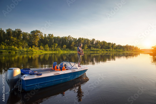 Printed kitchen splashbacks Fishing Mature man on a motor boat. Fishing.