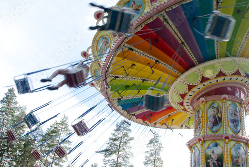 Poster Amusementspark Kouvola, Finland 7 June 2016 - Ride Swing Carousel in motion in amusement park Tykkimaki