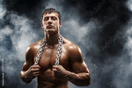 фотографія  Portrait of muscular sportsman with metal chain on neck
