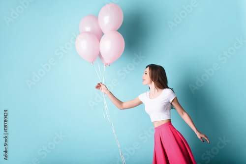 Happy young woman having fun with inflatables