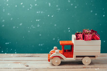 Christmas Gift Boxes In Wooden Toy Truck