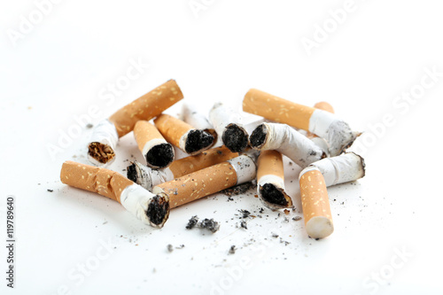 Cigarette butts with ash isolated on a white Tablou Canvas