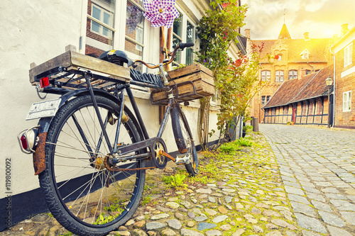 Aluminium Prints Bicycle Vintage Bicycle On House Wall At Sunset, Old Town Street,