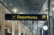 Departures airport sign