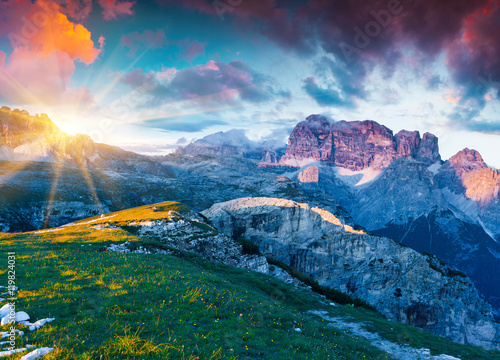 Colorful summer sunrise on Gruppo del Cimonega mountain range Wallpaper Mural