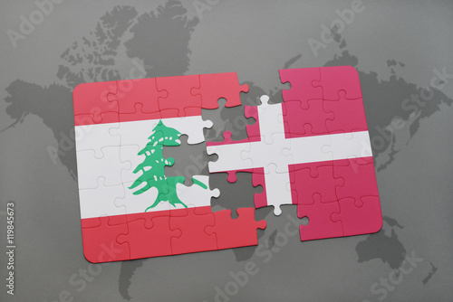 puzzle with the national flag of lebanon and denmark on a world map background Poster