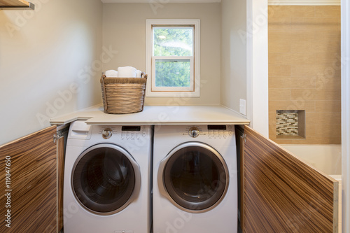 Fotografie, Obraz  Front Load Washer And Dryer With Open Wooden Closet. Great desig